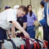 Matt Belzak straps a patient on a stretcher while working for Syracuse University Ambulance in 1997. Photo © by Bradley Wilson. 708C12
