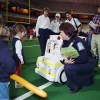 Syracuse University Ambulance students Marcia Merring, Kristina Forget and David Flores work with staff of Rural/Metro in 1996 to educate students in the Carrier Dome. Photo © by Bradley Wilson 701AC16
