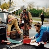Kelly Hirsch, then president of the Syracuse University Ambulance and an EMT-D, works with the Syracuse Fire Department at a simulated DWI accident on campus in 1996. Photo by Bradley Wilson 694C15A