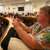 Val Kibler taks a photo on her smartphone at the Virginia Journalsim Camp June 23, 2013.