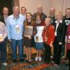 John Bowen, Mitch Eden, Jim McGonnell, Dow Tate, Lori Keekley, Karl Grubaugh, Valerie Kibler, Candace Bowen, Jim Streisel, Robin Sawyer, Aaron Manfull, Ellen Austin. Past and present recipients of the National High School Journalism Teacher of the Year Award at the National High School Journalism Convention in Indianapolis, Nov. 12, 2016. Photo by Bradley Wilson