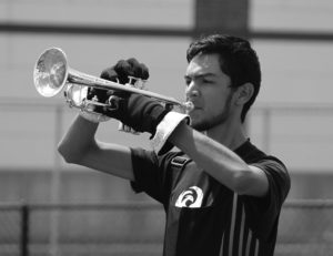 "Trumpet player Albert Escobedo said he believes that being in a drum corps is just as much of a sport as football or basketball. Many times, their training days are 12 hours long with 4-hour block periods. Escobito said they also wake up each morning and do 45 minutes of physical training, ""I would definitely consider it a sport. If you take into account all the training and preparation that needs to be accounted for moving in."" Photo by Kayla Ebner kayla3976@yahoo.com"