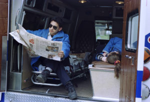 David Flores and his partner relax on a standby with Syracuse University EMS in 1996. Photo © by Bradley Wilson